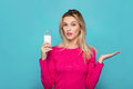 Blonde young woman a glass of milk on blue Royalty Free Stock Photo