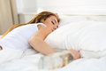 Blonde young woman lying in bed deadly drunken Royalty Free Stock Photo
