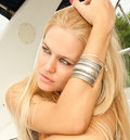Blondy woman sitting on the deck of her yacht Royalty Free Stock Image