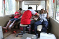 Blood donation residents of social action in a bus at the roadside in the city of solo central java indonesia Royalty Free Stock Photo