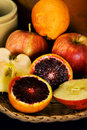 Blood oranges and apples Royalty Free Stock Photo