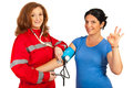 Blood pressure it is okay doctor women measure to patient women and Royalty Free Stock Photo