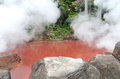 Blood red hot spring in beppu a like the kamado jigoku or cooking pot hell attraction ferrous oxide the water tints it the Royalty Free Stock Photo