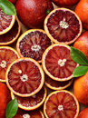 Blood red oranges sicilian sliced on wood Royalty Free Stock Photography