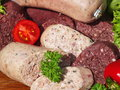 Blood sausage and liver sausage on a bed of oak Stock Images