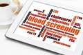Blood screening health concept healthcare word cloud on a digital tablet with cup of coffee Royalty Free Stock Photos