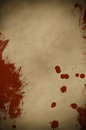 Blood spattered parchment an old dark piece of paper splattered and smeared with red paint to simulate Stock Photo