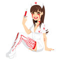 Bloody halloween nurse attractive girl in costume holding a syringe with red fluid Royalty Free Stock Image