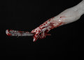 Bloody hand holding an adjustable wrench, bloody key, crazy plumber, bloody theme, halloween theme, black background,isolated Royalty Free Stock Photo