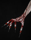 Bloody hand with syringe on the fingers toes syringes hand syringes horrible bloody hand halloween theme zombie doctor black Royalty Free Stock Photos