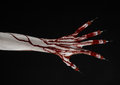 Bloody hand with syringe on the fingers toes syringes hand syringes horrible bloody hand halloween theme zombie doctor black Stock Photo