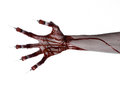 Bloody hand with syringe on the fingers toes syringes hand syringes horrible bloody hand halloween theme zombie doctor white Stock Images