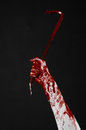 Bloody hands with a crowbar hand hook halloween theme killer zombies black background isolated bloody crowbar studio Royalty Free Stock Images