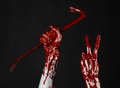 Bloody hands with a crowbar hand hook halloween theme killer zombies black background isolated bloody crowbar studio Stock Photography