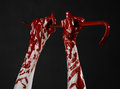 Bloody hands with a crowbar hand hook halloween theme killer zombies black background isolated bloody crowbar studio Stock Image