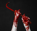 Bloody hands with a crowbar hand hook halloween theme killer zombies black background isolated bloody crowbar studio Royalty Free Stock Image