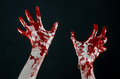 Bloody hands in white gloves a scalpel a nail black background zombie demon maniac studio Stock Photo