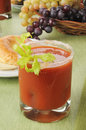 Bloody mary a with a bagel in the background Royalty Free Stock Photography