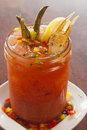 Bloody mary garnished with green beans and a crab claw spicy smoked chipotle Stock Image