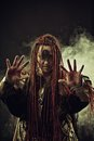 Bloody omen wicked shaman with hands in smoke Stock Photography