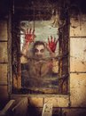Bloody zombie at the window photo of a outside a that is covered with blood spiderwebs and filth Royalty Free Stock Photos