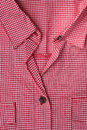 Blouse front of a red gingham showing pockets collar and buttons Stock Photo