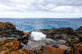 Blow hole with water spraying out. Maui, Hawaii, USA Royalty Free Stock Photo