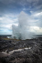 Blowhole on rocky coastline Stock Photo