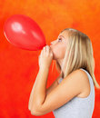 Blowing balloon Royalty Free Stock Photos
