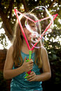 Blowing big bubbles Royalty Free Stock Photo