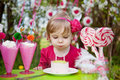 Blowing  birthday candles Royalty Free Stock Images