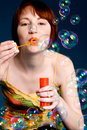 Blowing the bubbles Stock Images