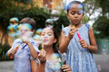 Blowing bubbles group of children soap Royalty Free Stock Photos