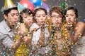 Blowing confetti asian young people in the air Royalty Free Stock Photos