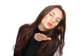 Blowing kiss cute young woman a Royalty Free Stock Photography