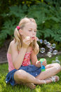 Blowing many bubbles Stock Images