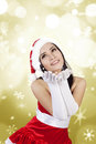 Blowing snowflakes by Mrs. Clause in golden lights Royalty Free Stock Photos