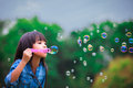 Blowing a soap bubbles Stock Photography