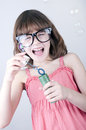 Blowing soap bubbles child having fun Royalty Free Stock Image