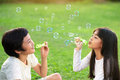 Blowing soap bubbles children in the park Stock Photo