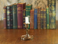 Blown candle with vintage candlestick on wooden table Stock Photo