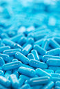 Blue сapsule pills medicine antibiotic pharmaceutical theme heap of capsule with shallow dof Royalty Free Stock Image