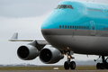 Blue 747 jumbo jet on runway Royalty Free Stock Photo
