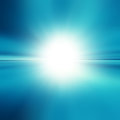 Blue abstract background with white spot light tropical horizon with sunburst Royalty Free Stock Images