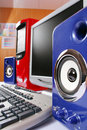 Blue acoustic systems with red computer Royalty Free Stock Photo