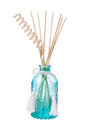 Blue air freshener bottle with scented sticks isolated on white Stock Images