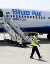 Blue Air plane parked at Bucharest Baneasa airport Royalty Free Stock Photography