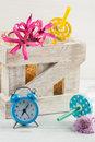 Blue alarm clock, bottles with pink lilly Royalty Free Stock Photo