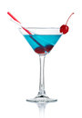 Blue alcohol cocktail in martini glass isolated