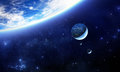 Blue alien planet with moons Royalty Free Stock Photo